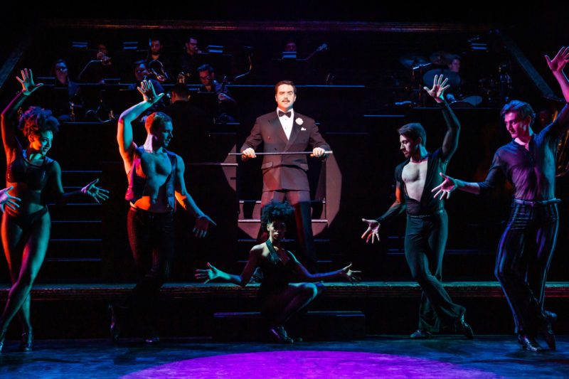 """scene from CHICAGO Billy Flynn and Company performing """"Razzle Dazzle"""""""
